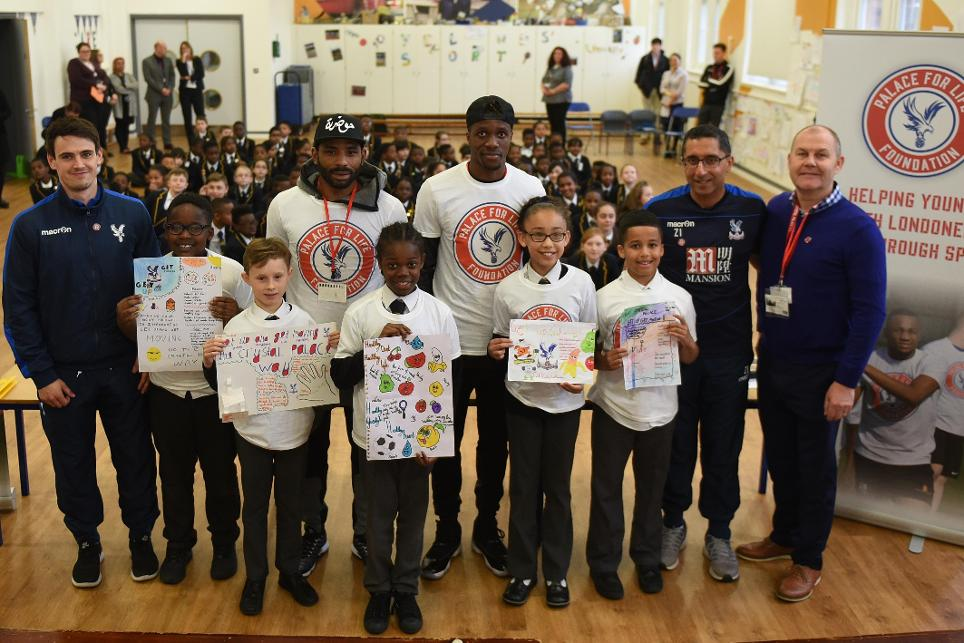 Wilfried Zaha and Jason Puncheon at Oasis Ryelands primary school