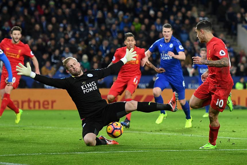 Kasper Schmeichel makes a save from Philippe Coutinho