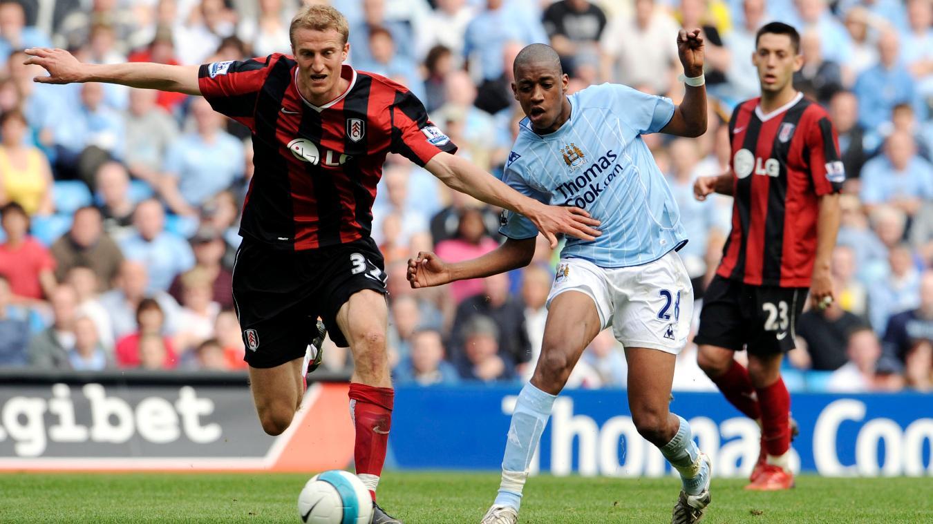 Fulham's Brede Hangeland challenges Gelson Fernandes