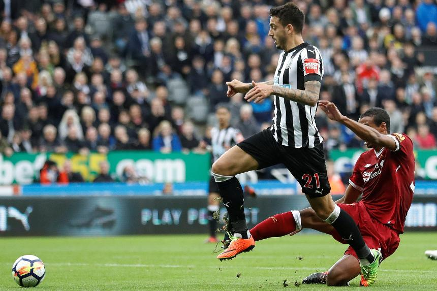 Newcastle United's Joselu scores their first goal against Liverpool