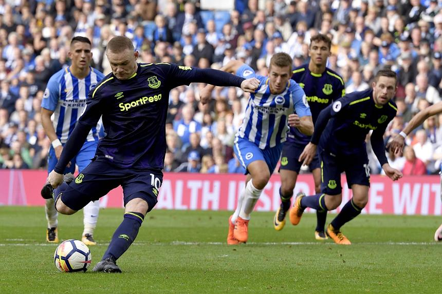 Wayne Rooney scores a late penalty for Everton against Brighton