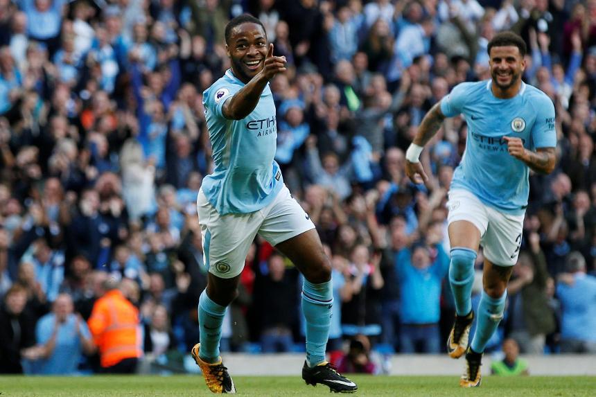Raheem Sterling celebrates his goal against Stoke City