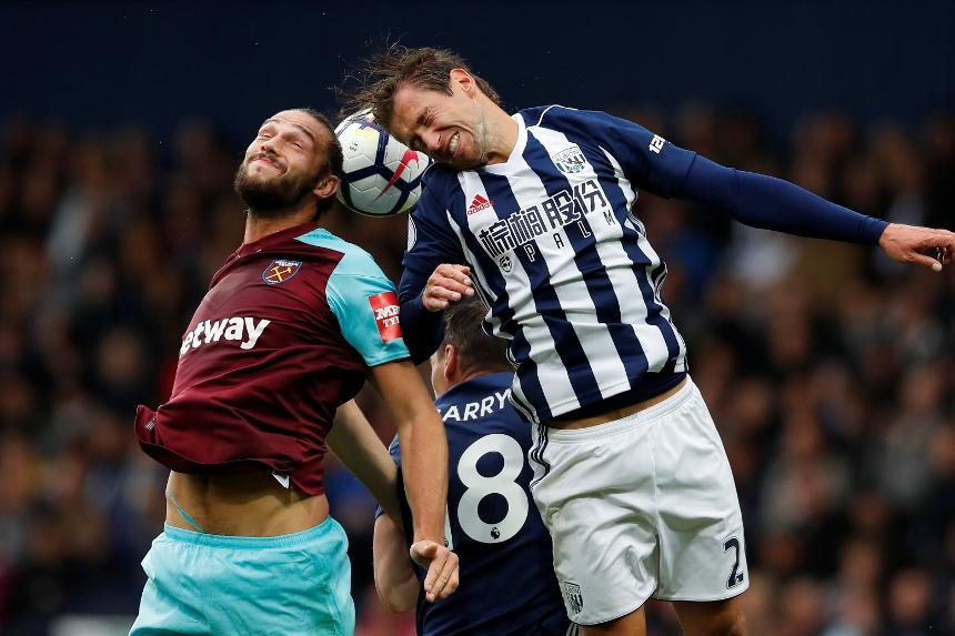 Andy Carroll, of West Ham, and Grzegorz Krychowiak, of West Bromwih Albion