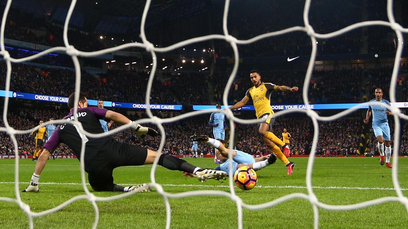 Theo Walcott scores against Manchester City last season