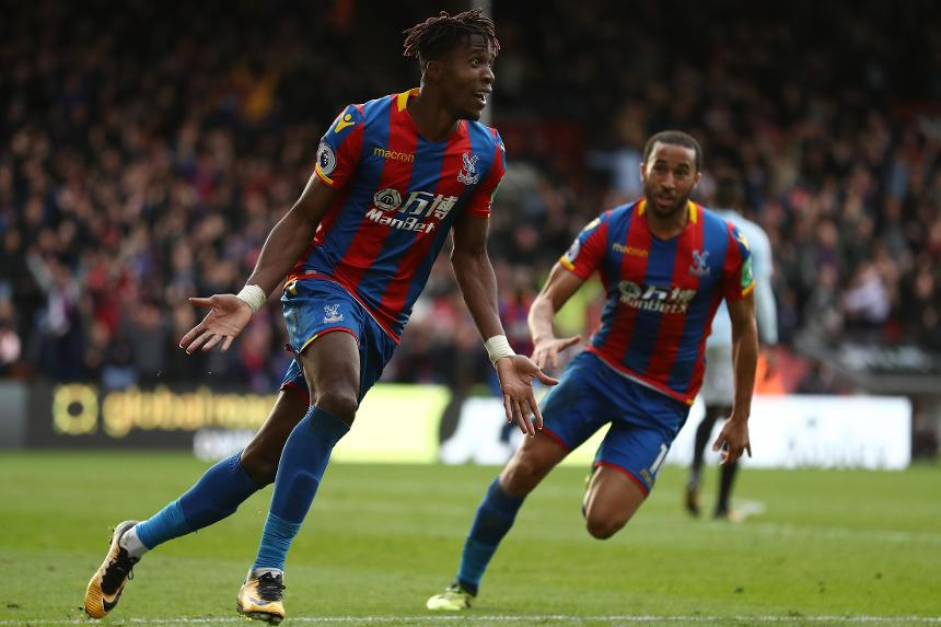Wilfried Zaha and Andros Townsend celebrate the late equaliser against West Ham