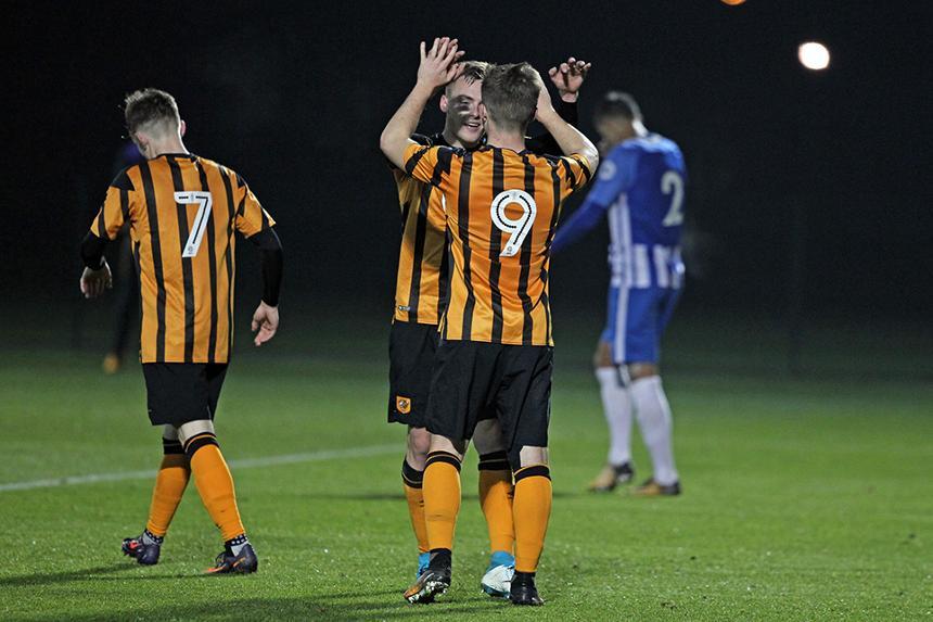 Hull City players celebrate scoring at Brighton