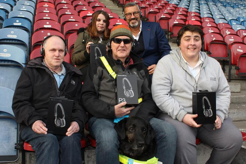 Huddersfield Town fans with new headphones