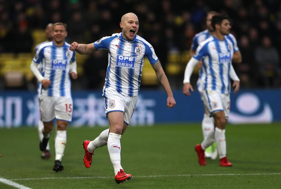 Aaron Mooy  celebrates scoring Huddersfield's second goal against Watford