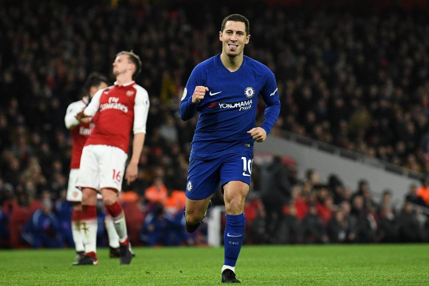 Eden Hazard celebrates scoring a penalty for Chelsea against Arsenal