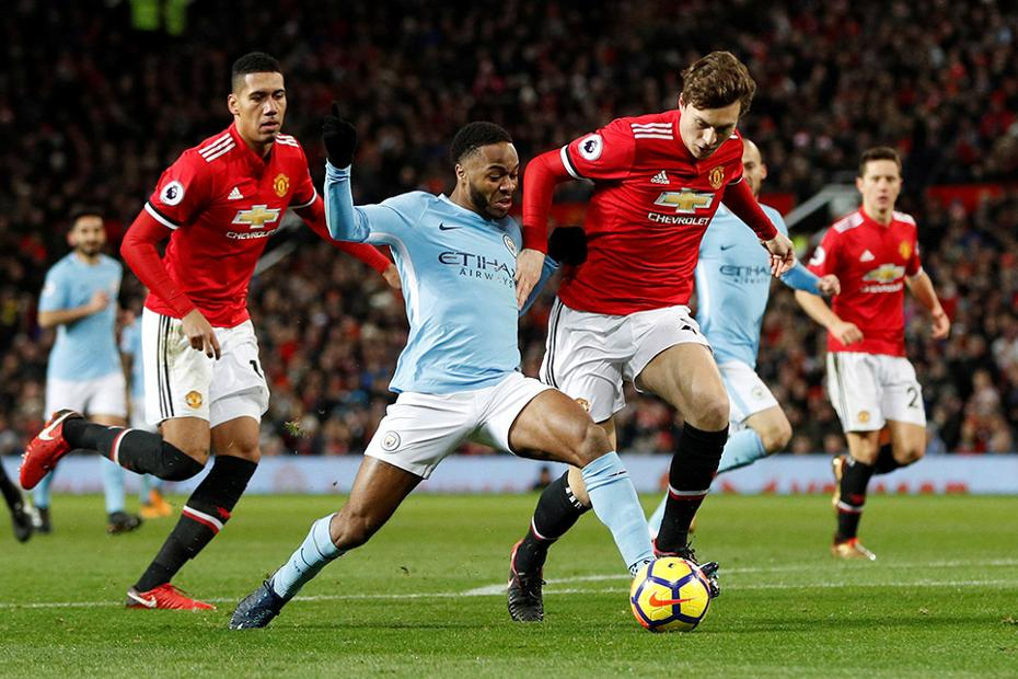 Raheem Sterling in action against Man Utd's Chris Smalling and Victor Lindelof
