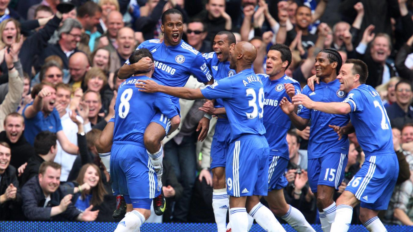 Didier Drogba celebrates with Chelsea teammates in 2009/10
