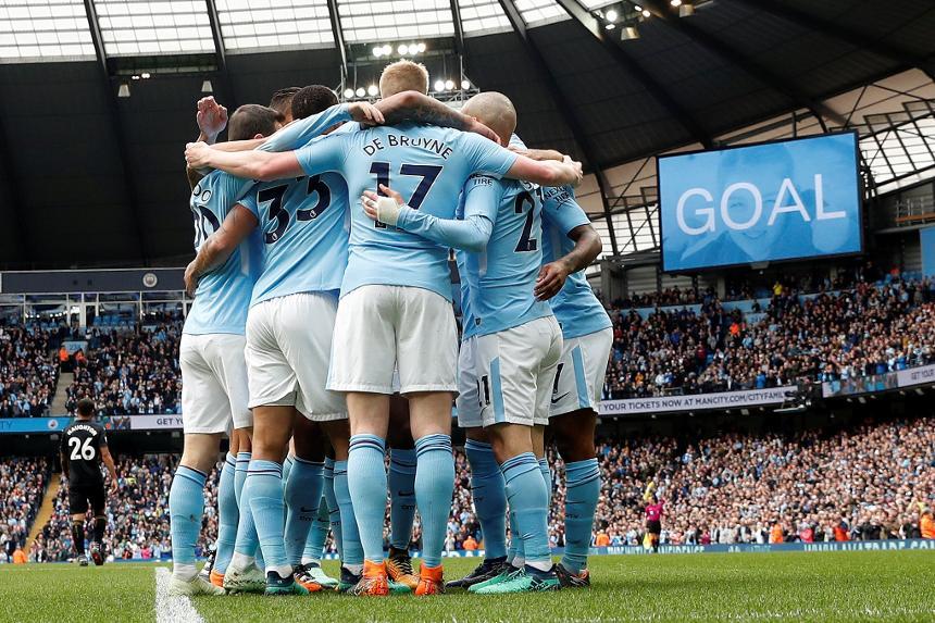 Man City celebrate a goal v Swansea City