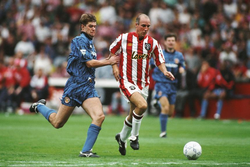 Alan Cork, of Sheffield United, against Man Utd's Gary Pallister