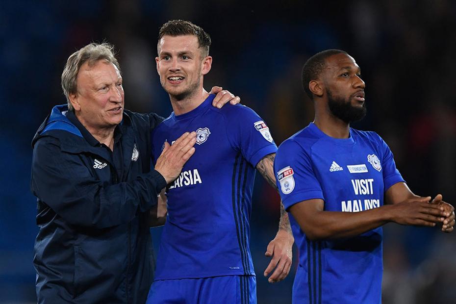 Neil Warnock, Joe Ralls, and Junior Hoilett, of Cardiff City