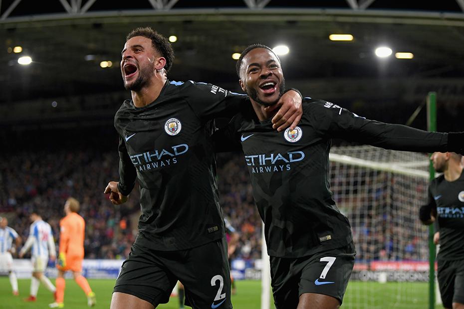 Kyle Walker and Raheem Sterling celebrate a goal for Man City