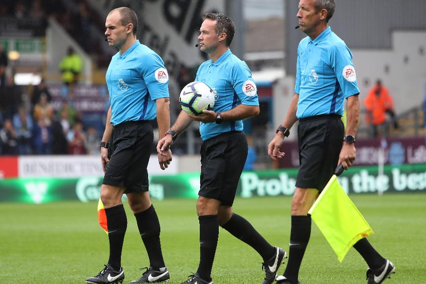 Referee Paul Tierney and assistant referee's Adrian Holmes and Michael McDonough