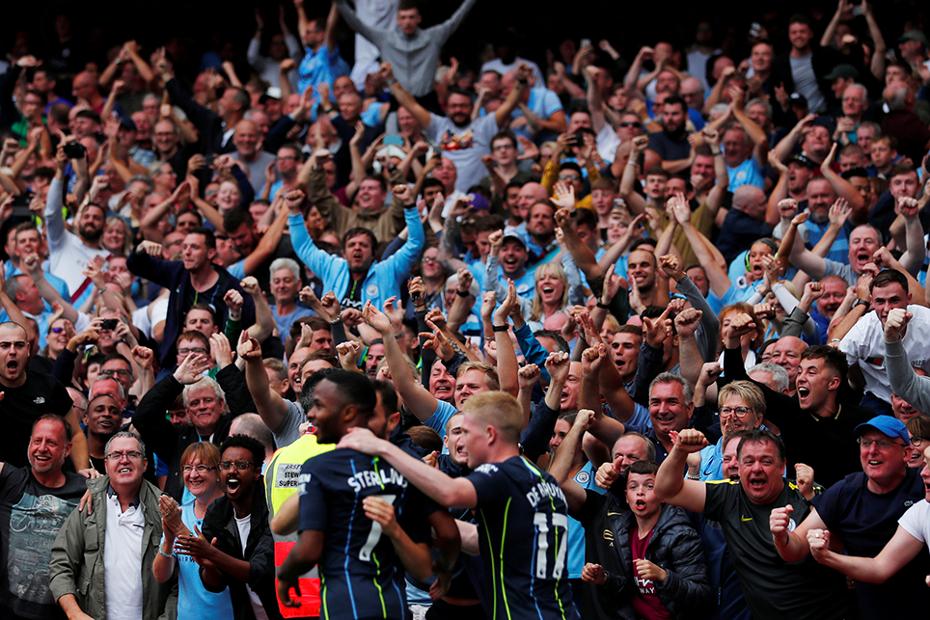 Man City fans celebrate v Arsenal