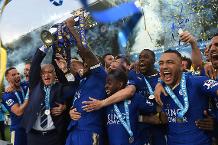 Leicester City celebrate winning the Premier League Trophy