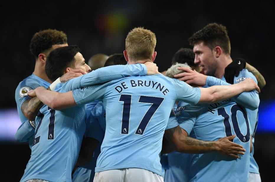 Man City celebrate scoring against Arsenal
