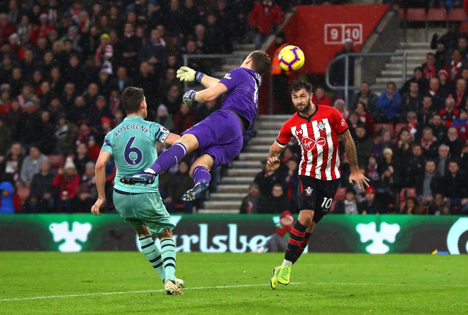 Southampton striker Charlie Austin and Arsenal goalkeeper Bernd Leno